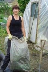 Linda volunteers organic gardening