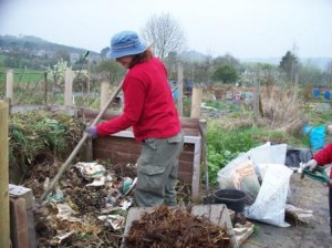 Turning over compost bin